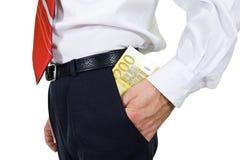 Zet het geld int. hij zak Royalty-vrije Stock Fotografie