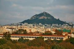 Zet Lycabettus op toenemend van Athene stock afbeeldingen