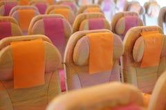 Zetels in vliegtuigcabine Stock Foto
