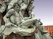 Zeus. Statue of the god Zeus in a fountain (Fontana Dei Quattro Fiumi) in Piazza Navona (Rome - Italy Stock Image