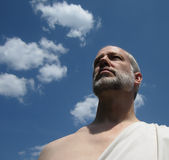 Zeus. Man with a beard wearing a toga Royalty Free Stock Photography
