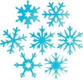 Zeven blauwe sneeuwvlokken. Stock Afbeeldingen