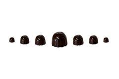Zeven chocoladesnoepjes Stock Foto's