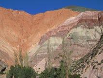 Zeven gekleurde berg Stock Foto's