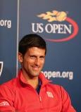 Zeven keer Grote Slagkampioen Novak Djokovic tijdens persconferentie in Billie Jean King National Tennis Center Stock Foto's