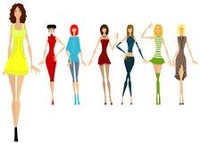 Zeven mooie meisjes in verschillende kleren Stock Foto