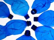 Zeven plastic flessen Stock Fotografie