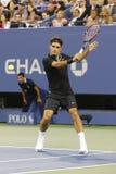 Zeventien keer Grote Slagkampioen Roger Federer tijdens eerste ronde gelijke bij US Open 2014 Stock Foto