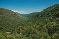 Zezere River valley. A long green canyon formed by glacier thousands of years ago, in a sunny day at Serra da Estrela. The highest mountain range in royalty free stock photo