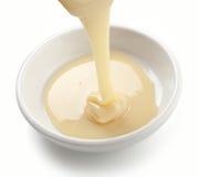 Zgęszczony mleko Obrazy Stock