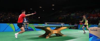 Zhang Jike que joga o tênis de mesa nos Jogos Olímpicos no Rio 2016 Fotografia de Stock Royalty Free