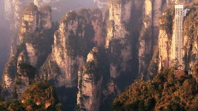 Zhangjiajie Sunrise Elevator Mountains. High-speed elevator in Zhangjiajie mountains on a sunrise. China stock footage