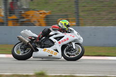 Zheng Wei Man in ZIC superbike race. Zheng Wei Man was riding his Suzuki GSXR600 in race 1 of ZIC superbike race.  However his position was only last 4 of 32  in Royalty Free Stock Photos