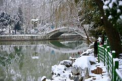 Snow Scenery in Zhengzhou People& x27;s Park. Zhengzhou People& x27;s Park is located on the west side of North 27th Road in the urban center. It was established stock photography