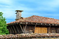 Old traditional rustic house in Zheravna, Bulgaria. Zheravna, Bulgaria - Single authentic rustic house made of stone and wood with closed wooden shutters and royalty free stock image