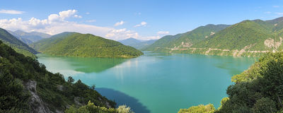 Zhinvali Reservoir on the Aragvi River in Georgia. Panorama of the Zhinvali Reservoir on the Aragvi River in the Caucasus Mountains in Georgia Royalty Free Stock Photos