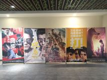 Posters of the recent movies in a cinema. Zhongshan,China-August 20, 2017:posters of the recent movies in a cinema,the wolf warrior 2 in the middle brings more Royalty Free Stock Images