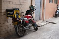 Motobike with Meituan food delivery case parking on the street. Zhongshan,China-May 12,2018:motobike with Meituan food delivery case parking on the street.Food Royalty Free Stock Image