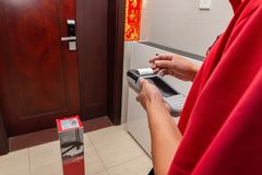 JD.com courier preparing a payment receipt in front of a customers home. Zhongshan,China-November 2,2018:JD.com courier preparing a payment receipt in front of a royalty free stock image