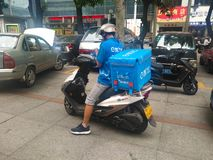 E le ma food delivery people checking the mobile before delivering food to the custo. ZHONGSHAN GUANGDONG CHINA - October 23, 2018: E le ma food delivery people royalty free stock photos