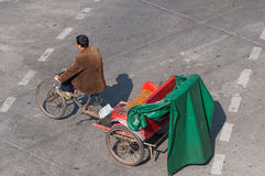 Zhongshan:tricycles on urban street Stock Images