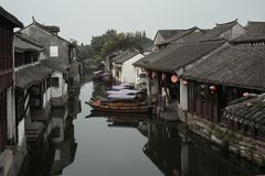 ZHOUZHUANG, CHINA: Old houses and boat reflection in a village canal royalty free stock images