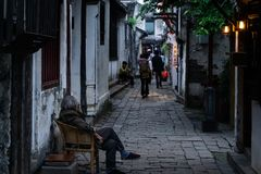 Zhou zhuang. Some elders sit in the alley to enjoy the cool in the dusk Stock Photography