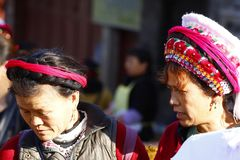 Women from various ethnic minorities of Yunnan with their traditional clothes in the market of Zhoucheng village, Yunnan, China. Zhoucheng village, Yunnan, China royalty free stock images