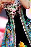 Zhuang clothes and jewelry. Details of a dress and jewelry of a girl in traditional Zhuang clothes from China Stock Images