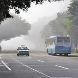 Zhuhai,China:bus in fog Royalty Free Stock Photos