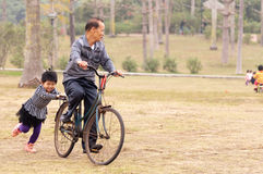 Riding with grandpa on a bike Royalty Free Stock Photos