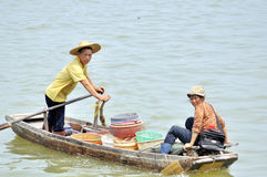 Zhuhai,Fishermen and small boat Stock Photo
