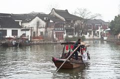 Local man rowing along a canal in Zhujiajiao water town, Shanghai, China Royalty Free Stock Images
