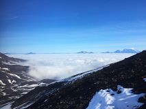 View of clouds in the valley from the slope of the Avachinsky volcano. stock photo