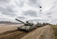 Armed Forces of Ukraine. ZHYTOMYR Reg, UKRAINE - Oct. 14, 2017: Column of tanks and fighters in the sky. Combat training of the Armed Forces of Ukraine in the Royalty Free Stock Photography