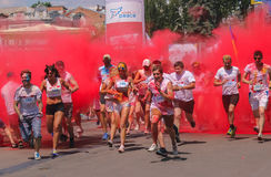 Zhytomyr, Ukraine - June 25, 2016: happy people crowd partying under colorful powder cloud run competition at holi fest. Zhytomyr, Ukraine - June 25, 2016: happy stock images
