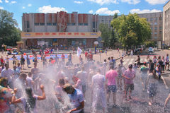 Zhytomyr, Ukraine - June 25, 2016: happy people crowd partying under colorful powder cloud run competition at holi fest. Zhytomyr, Ukraine - June 25, 2016: happy royalty free stock images