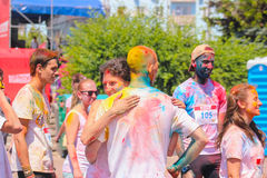 Zhytomyr, Ukraine - June 25, 2016: happy people crowd partying under colorful powder cloud run competition at holi fest royalty free stock image