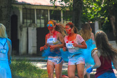 Zhytomyr, Ukraine - June 25, 2016: happy people crowd partying under colorful powder cloud run competition at holi fest. Zhytomyr, Ukraine - June 25, 2016: happy royalty free stock photo