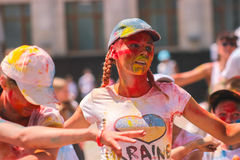 Zhytomyr, Ukraine - June 25, 2016: happy people crowd partying under colorful powder cloud run competition at holi fest. Zhytomyr, Ukraine - June 25, 2016: happy royalty free stock photos