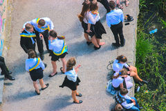 Zhytomyr, Ukraine - May 28, 2015: Last call for school holidays in school yard. Graduates of elementary middle school dance at the ball and release of doves of royalty free stock photography