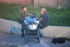 Zhytomyr, Ukraine - October 19, 2017: an old man and a woman with a stroller Royalty Free Stock Image