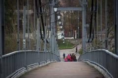 Zhytomyr, Ukraine - September 05, 2015: bridge at Zhytomyr Footbridge. Zhytomyr, Ukraine - September 05, 2015: Old woman call-down guys, that climbing on wreck Royalty Free Stock Photo
