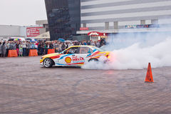 ZHYTOMYR, UKRAINE - SEPTEMBER 05 2015: Sports a car in a cloud of smoke Stock Photography