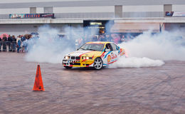 ZHYTOMYR, UKRAINE - SEPTEMBER 05 2015: Sports a car in a cloud of smoke Royalty Free Stock Photos