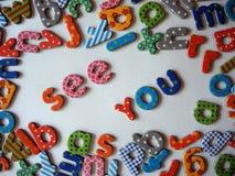Zie u banner met kleurrijke brieven stock foto