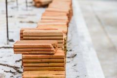 Ziegelstein des roten Lehms Stockbilder