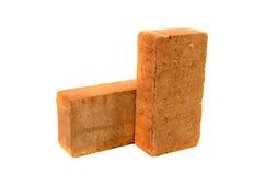 Ziegelstein des roten Lehms lokalisiert auf weißem Hintergrund Stockbild