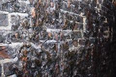 Ziegelstein geschmolzen von der Hitze Stockbild