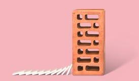 Ziegelstein mit unten fallen Dominos Lizenzfreie Stockfotos